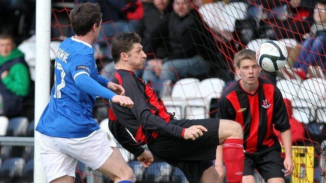 Paul Leeman clears the ball against Linfield