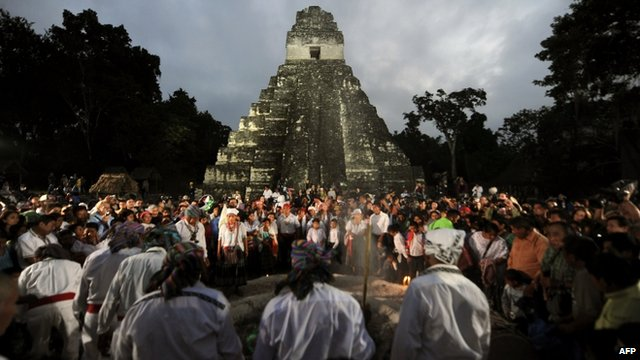 Guatemalan natives and visitors take part in a ceremony