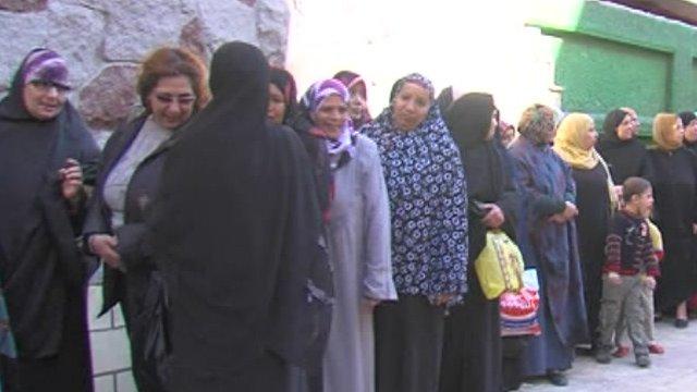 Women queue to vote