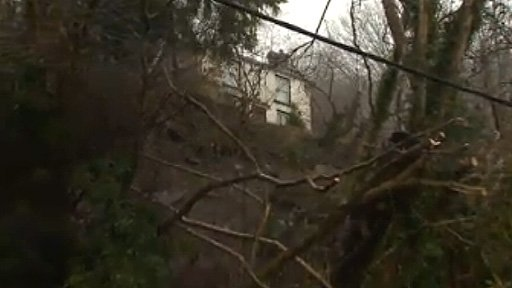 House on edge after landslip