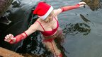 A member of a Berlin swimming club takes a Christmas Day dip in the Orankesee lake. Photo 25 December
