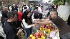 An Israeli couple buy pomegranate juice at the Festival of Festivals in Haifa (photo credit: Ariel Jerozolimski)