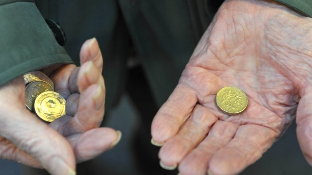 Pensioners hands holding coins