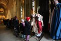 The Archbishop of Canterbury, Dr Rowan Williams greets young children and members of the congregation after giving his final Christmas Day address at Canterbury Cathedral