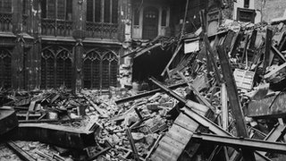 The chamber of the House of Commons after it was bombed in 1941