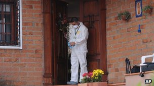 Forensic expert outside the house in Envigado