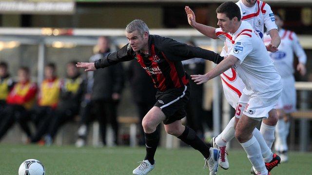 Gary McCutcheon of Crusaders in action against Portadown defender Chris Ramsey