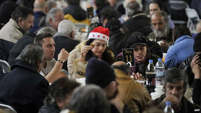Homeless people are served a New Year's dinner offered by the municipality of Athens