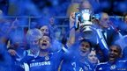 Chelsea players cheer after winning the the FA Cup trophy on 5 May 2012