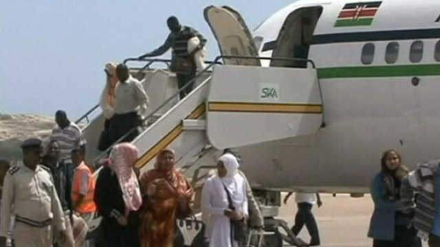 Somali refugees getting off a plane