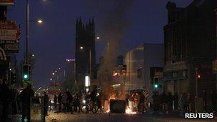 Loyalist youths burn debris in the Newtownards Road