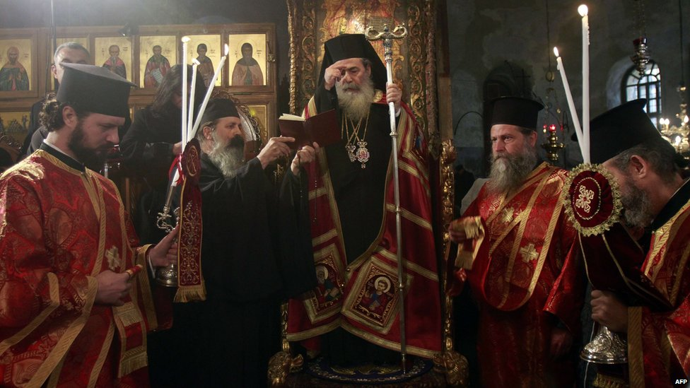 greek orthodox patriarch of jerusalem theophilos iii crosses himself on christmas eve in the
