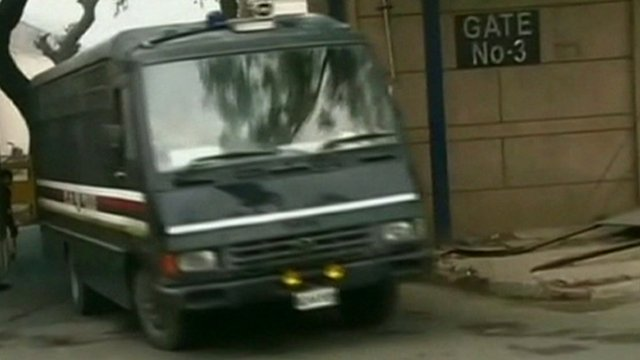 Police van carrying the men accused of the gang rape and murder of a medical student