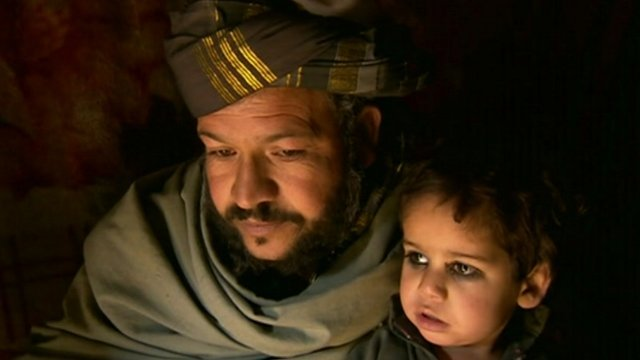 Man and child in Kabul camp