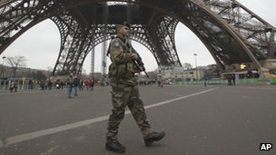 A French soldier patrols in front of the Eiffel Tower in Paris. Photo: 13 January 2013