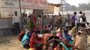 People sitting outside the lost and found camp at the Kumbh Mela