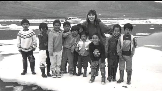 Galya with children standing on ice