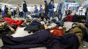 Passengers sleep on the floor in Narita Airport, Japan (15 Jan 2013)