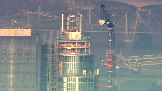 Tower and crane which helicopter hit