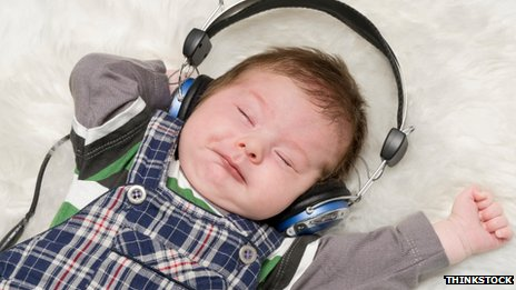 A baby with headphones on