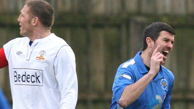 Steven Feeney celebrates after scoring Ballinamallard's first goal against Glenavon