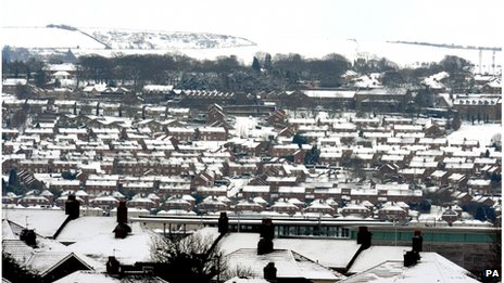 Snow-covered Newcastle rooftops
