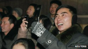 North Koreans take photos on mobile phones at New Year in Pyongyang (1 Jan 2013)