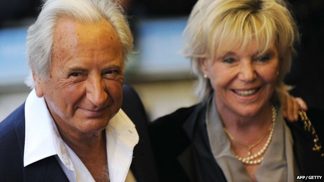 British film director Michael Winner (L) and his wife Geraldine Lynton-Edwards