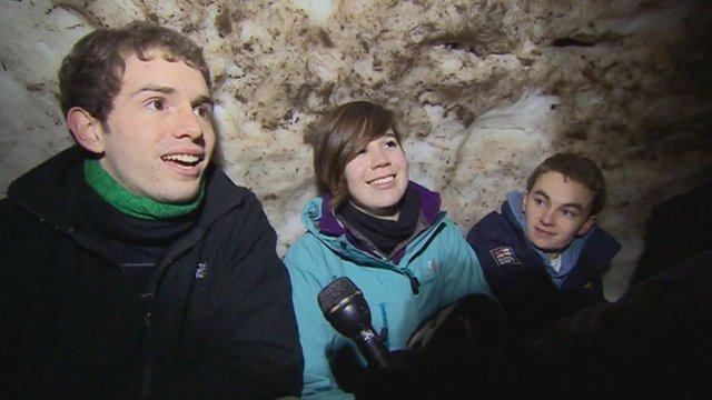 Bristol university students inside the igloo they built on Clifton Downs