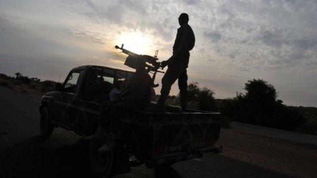 A Malian army armed pickup truck drives near Markala on 22 January 2013