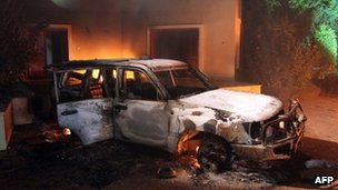 Burnt-out car during attack on US consulate in Benghazi