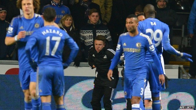 Swansea City ball boy Charlie Morgan recovers after being kicked by Chelsea star Eden Hazard