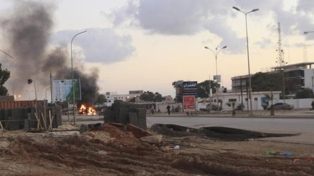 Police car burns after clashes in Benghazi in December 2012
