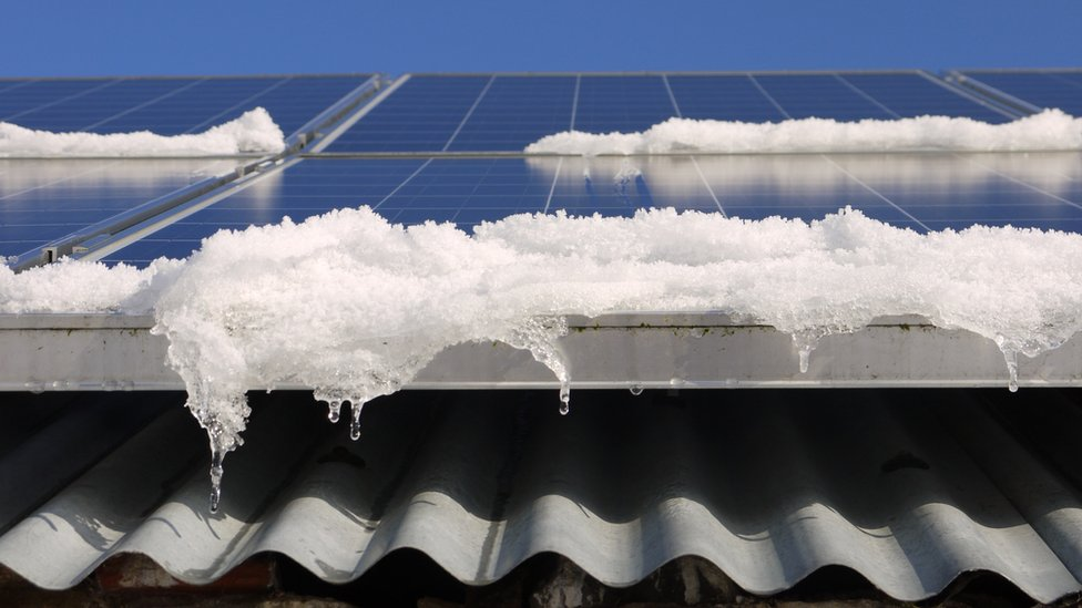 Snow melting off solar panels