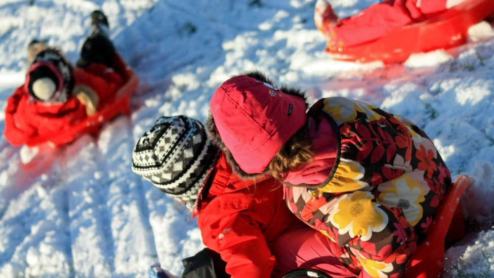 Orlyn sledging with her friends