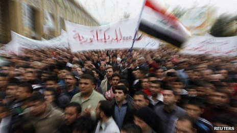 Iraqi Sunnis wave an Iraqi national flag during an anti-government demonstration in Baghdad, 25 January 2013