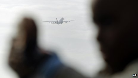 A boy takes a photograph as a Portuguese national airline TAP airplane takes off from Lisbon's Portela international airport, file pic from 20 December 2012
