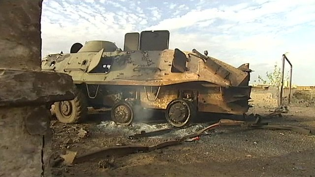 Damaged military vehicle