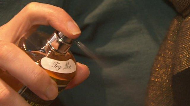 Woman sprays fragrance