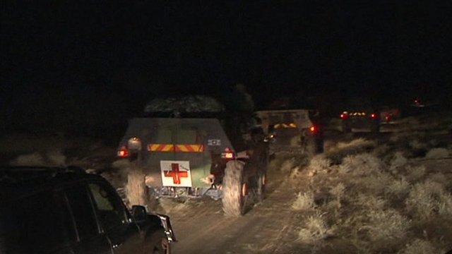 French-led troops advance in trucks across the desert toward Timbuktu