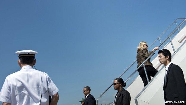 Hillary Clinton boards a plane