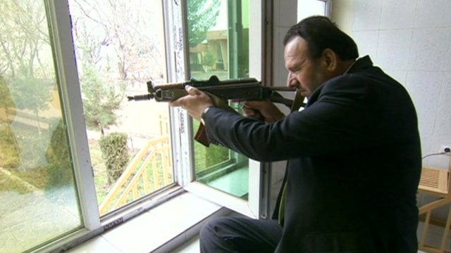 Governor of Parwan Basir Salangi with a gun