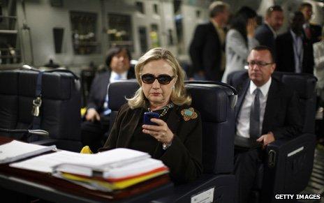 Clinton on her blackberry
