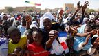 People gather to greet French President Francois Hollande in Timbuktu, 2 February 2013