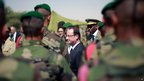 French President Francois Hollande addresses French troops at the airport in Timbuktu, Mali, 2 February 2013