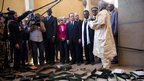 France's President Francois Hollande (5thR) flanked by Mali's interim president Dioncounda Traore (3dR), French Foreign Affairs minister Laurent Fabius (4thR) and UNESCO general director Irina Bokova (C) visit the archives where documents were burnt in Timbuktu, 2 February 2013
