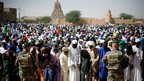 Well-wishers gather to greet French President Francois Hollande in Timbuktu, Mali, 2 February 2013
