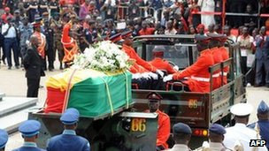 A military cortege with the body of Ghana's late President John Atta Mills on 10 August 2012 in Accra