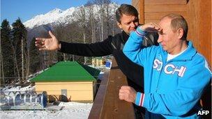 Russian President Vladimir Putin (R) speaks with Alexander Tkachev (L), Krasnodar region Governor, during a visit to the mountain resort in Krasnaya Polyana outside the Russian Black Sea resort of Sochi
