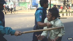 Police with suspected Jamaat-e-Islami supporter in Dhaka - 6 February